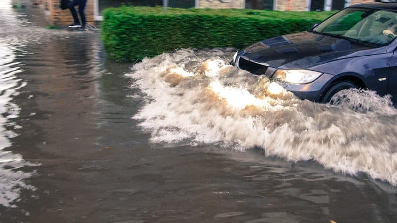 Car driving through flood waters in Margate, NJ