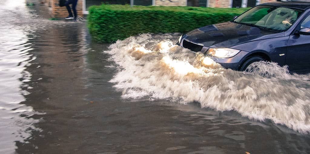 Vehicle driving through flood waters in Margate, NJ