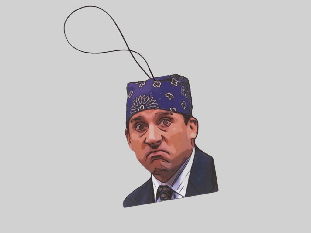 A product image for a car air freshener designed to look like Prison Mike from the office.