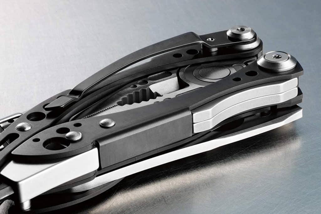 A product image for a multi-tool; the multi tool is black and silver, and appears to be closed with all of the various tools tucked away.