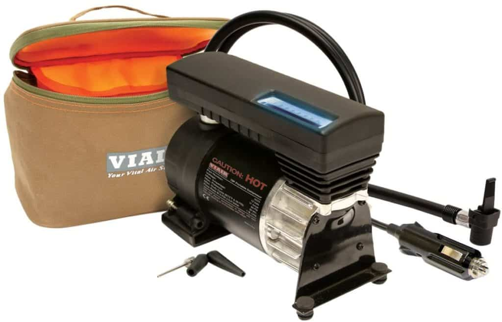 A product image for a portable tire inflator; the product is seen next to its carrying bag.