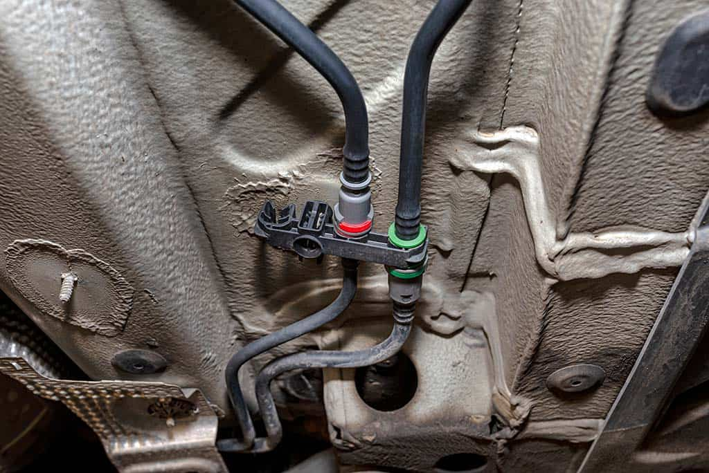Recently replaced fuel lines under a customers car chassis in Mays Landing, NJ