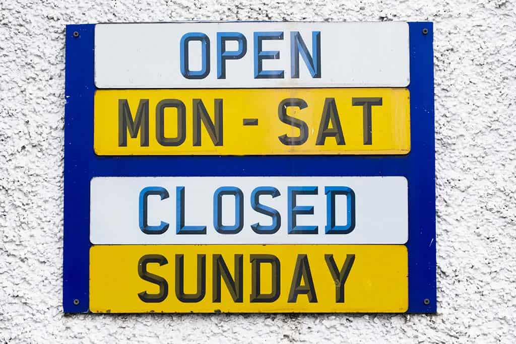 Dealership Hours Sign. Open: Monday - Saturday. Closed: Sunday.
